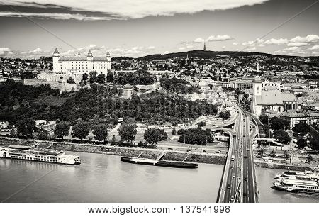 Bratislava is the capital city of Slovak republic. Embankment of Danube river Beautiful castle Saint Martin's cathedral. Architectural theme. Travel destination. Black and white photo.
