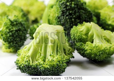 A close up of a Broccoli floret on white background selective focus.