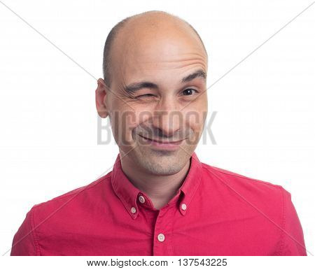 Cheerful Young Man Winking Isolated