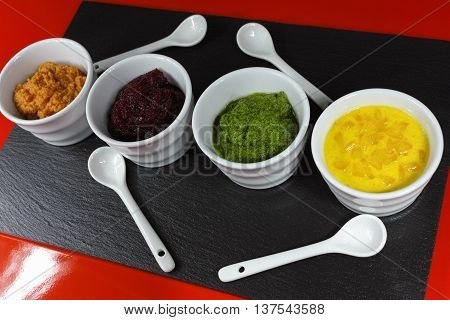 Healthy snacks - four colorful mousses from yellow paprika carrot red beet spinach