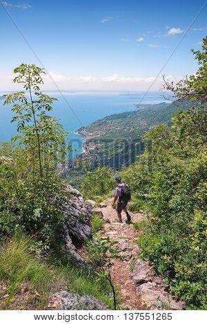 Backpacker At Idyllec Hiking Path Above Garda Lake