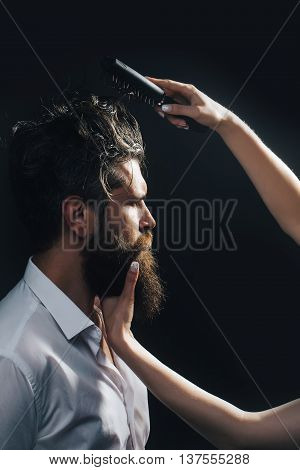 Female Hand Combing Bearded Man