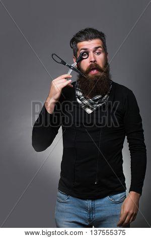 Bearded Man With Hairdresser Scissors