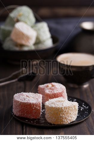 Sweet natural turkish delights on wooden background
