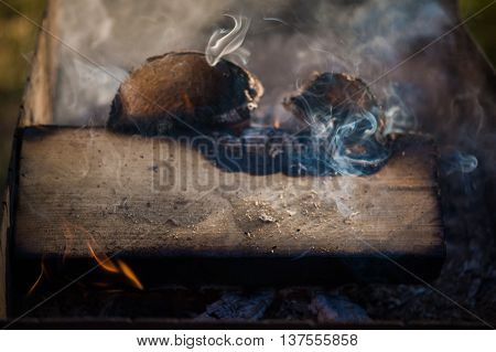 firewood and grill for barbecue. kindling fire