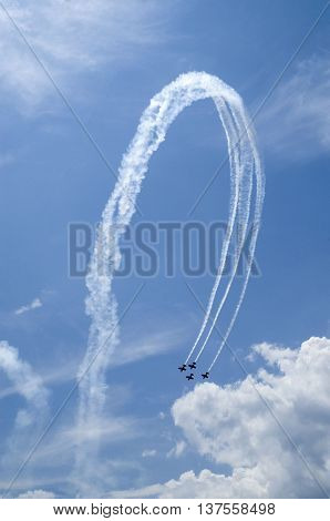 Small airplanes on air show with smoky trail