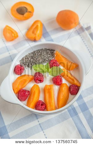 Yogurt with chia seeds, raspberries and apricot