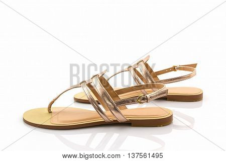 Women sandals shoes on the white background.