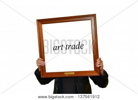 A man holding a picture frame up with the word