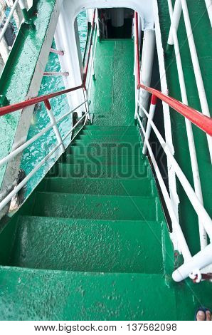 Green metal stairwell on ship, top view