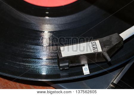 Above View Of Tonearm On Vinyl Record