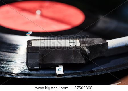 Tonearm On Vinyl Record In Old Turntable