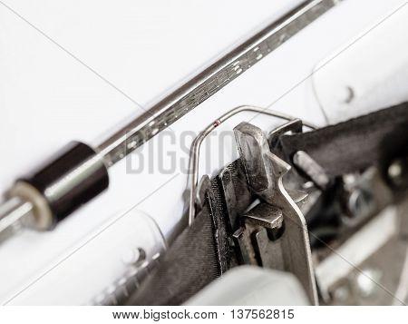 Side View Of Typebar Hits Ink Ribbon In Typewriter