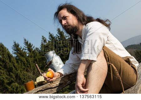 Eremite Making A Healthy Snack In The Nature