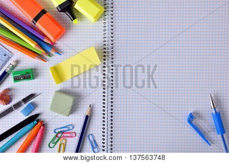 Open Notebook In Center Close Up With School Material