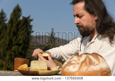 Bearded And Long-haired Man Making A Light Meal