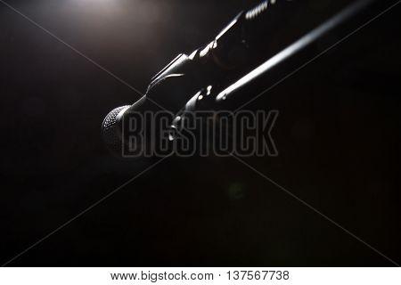 Black Microphone On Dark Background.
