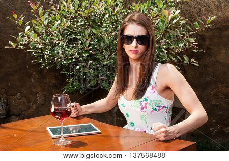 Mad Woman Waiting On Terrace With Wine