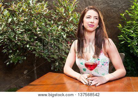 Dreamy Girl Enjoying Glass Of Wine On Terrace