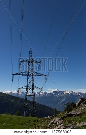 Electricity pylon in the mountains with blue sky