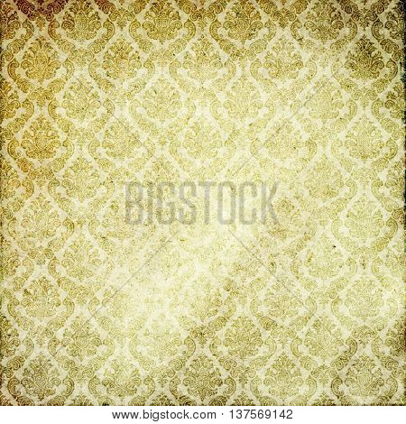 Aging dirty paper background with old-fashioned ornament. Vintage paper texture for the design.