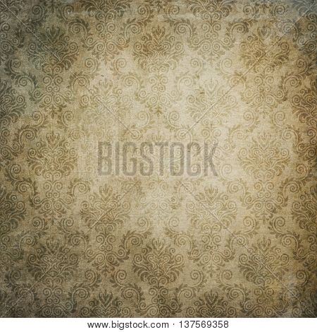 Aging dirty paper background with old-fashioned floral ornament. Vintage paper texture for the design.