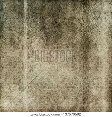 Old grunge paperbackground with old-fashioned patterns. Vintage texture for the design.