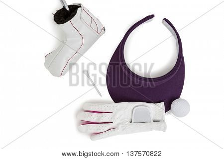 Close-up of various golf equipment on white background