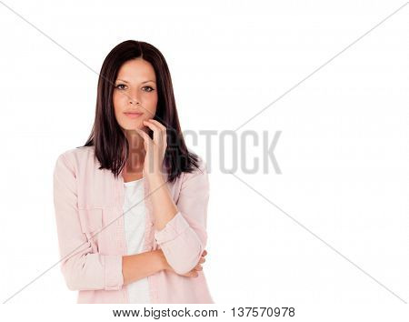 Pensive woman looking at camera having an idea isolated on white background