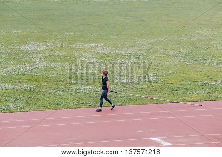 Chelyabinsk Russia - July 01 2016: girl is preparing for pole vault in stadium during Ural championship in athletics