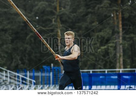 Chelyabinsk Russia - July 01 2016: male jumper prepares to pole vault during Ural championship in athletics