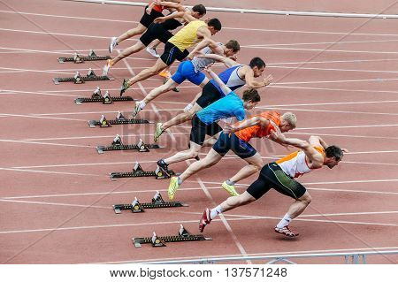 Chelyabinsk Russia - July 01 2016: start men athletes at sprint distance of 100 meters during Ural championship in athletics
