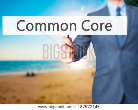 Common Core - Business Man Showing Sign