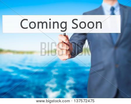 Coming Soon - Business Man Showing Sign