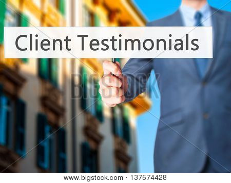Client Testimonials - Business Man Showing Sign