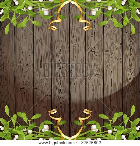 Wooden background with mistletoe borders