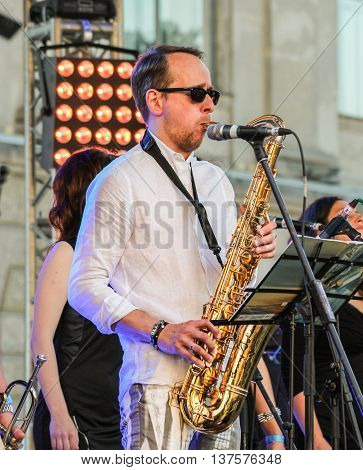 St. Petersburg, Russia - 2 July, The musician playing the saxophone, 2 July, 2016. Annual international festival of jazz and blues in St. Petersburg.