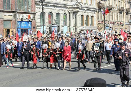 St. Petersburg, Russia - 9 May, Teens in the Caucasian clothes among people, 9 May, 2016. Memory Action