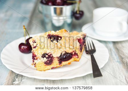 Slices of home made butter cherry cake with crumble topping