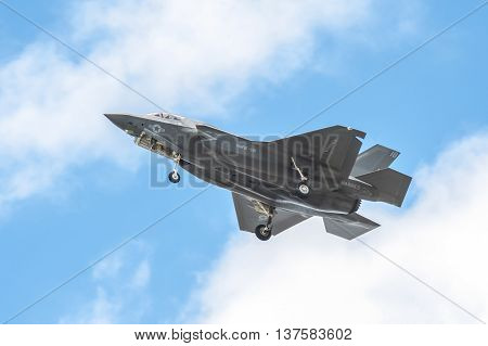 FARNBOROUGH, UK - JULY 5: Low level flight by a Lockheed Martin F-35B Lightning II, with undercarriage down, in the skies over Farnborough, Hampshire, UK on July 5, 2016