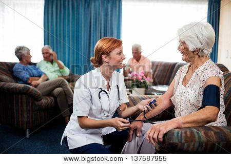 Nurse taking care of pensioner in the retirement house