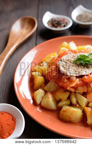 Pork cutlet with roasted potatoes, peppers and sauce