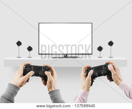 Man hold gamepad in hands in front of blank tv screen mock up playing game. Clear monitor mockup with gamer first person.