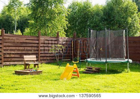Children Playground With Trampoline And Swings