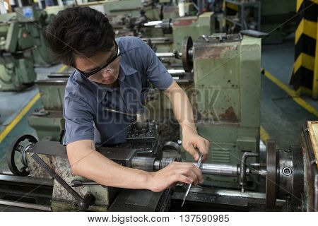 technician checking for workpiece steel on machine
