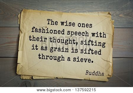 Buddha quote on old paper background. The wise ones fashioned speech with their thought, sifting it as grain is sifted through a sieve.