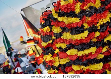 Row of chaplets (small wreaths) in the German national colors of black, red and yellow in the fan store selling the goods for supporters of the German national football team