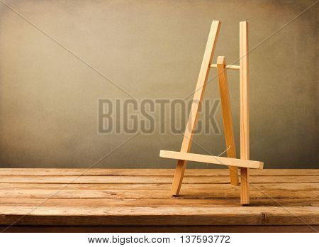 Background with empty wooden tripod on rustic deck