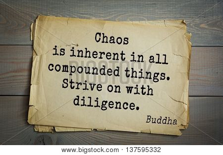 Buddha quote on old paper background. Chaos is inherent in all compounded things. Strive on with diligence.