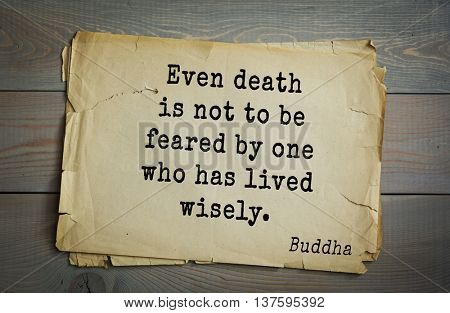 Buddha quote on old paper background. Even death is not to be feared by one who has lived wisely.